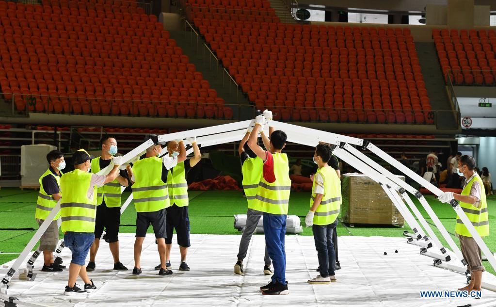 Builders set up the frame for a temporary laboratory for nucleic acid testing in a stadium in Guangzhou, capital of south China's Guangdong Province, June 1, 2021. Four nucleic acid testing laboratories, with each unit covering an area of 210 square meters, were erected in early morning on June 2, and are about to put into use on June 3. The laboratories are able to test over 120,000 samples a day, which will significantly improve the city's testing capability. (Xinhua/Liu Dawei)