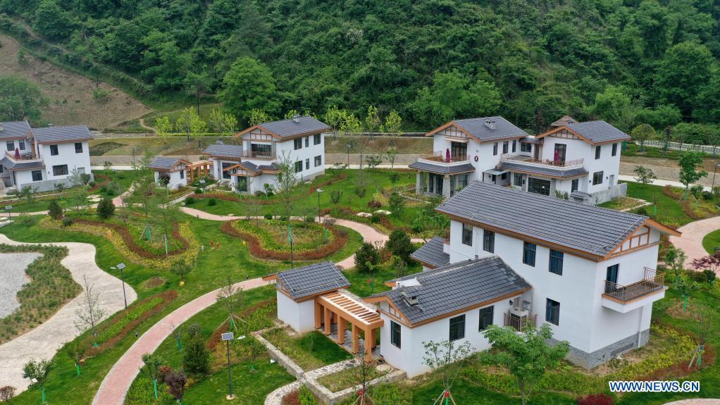 Aerial photo taken on May 21, 2021 shows a cluster of homestays in Zhujiagou Village of Kangxian County, Longnan City, northwest China's Gansu Province. (Xinhua/Chen Bin)