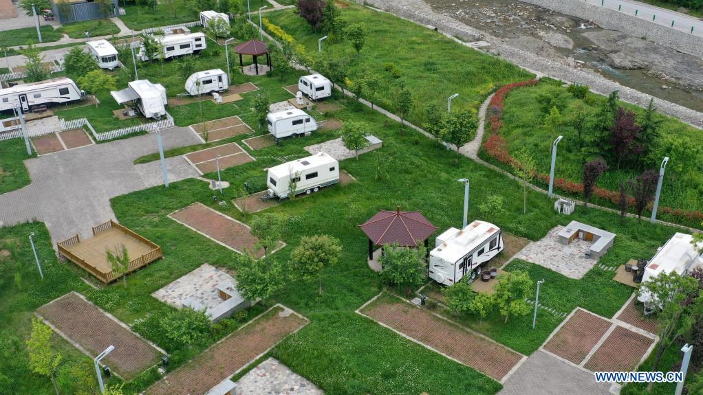 Aerial photo taken on May 20, 2021 shows an RV camp in Huaqiao Village of Kangxian County, Longnan City, northwest China's Gansu Province. (Xinhua/Lang Bingbing)