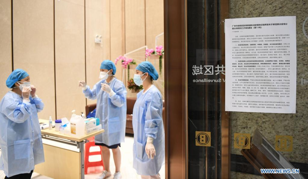 Volunteers prepare to disinfect a residential area at Liwan District of Guangzhou, capital of south China's Guangdong Province, June 2, 2021. Guangzhou has tightened anti-epidemic measures in parts of the city to curb the recent COVID-19 resurgence, local authorities said Tuesday. The city has implemented closed-off management on the Zhongnan subdistrict as well as 37 other locations and their surroundings. People in these areas must follow strict quarantine measures and stay indoors. Residents join the volunteer team, delivering food, necessities and epidemic prevention materials for people under home quarantine. (Xinhua/Deng Hua)