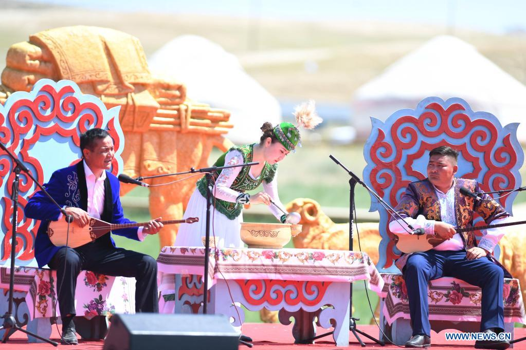 Artists perform during a tourism festival in Fuhai County of Altay, northwest China's Xinjiang Uygur Autonomous Region, June 3, 2021. (Xinhua/Sadat)