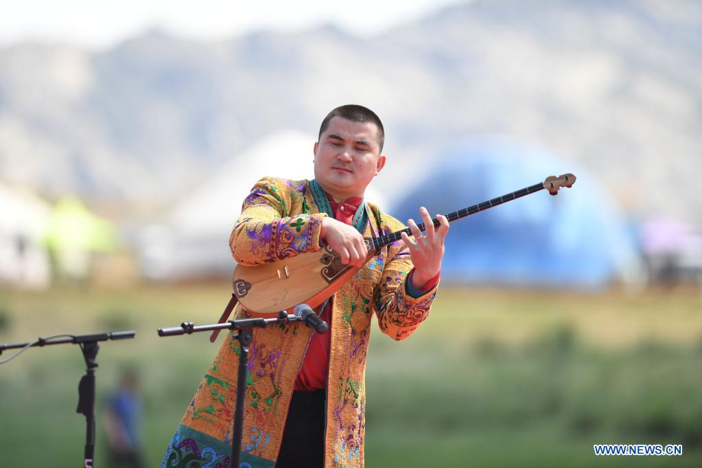An artist performs during a tourism festival in Fuhai County of Altay, northwest China's Xinjiang Uygur Autonomous Region, June 3, 2021. (Xinhua/Sadat)