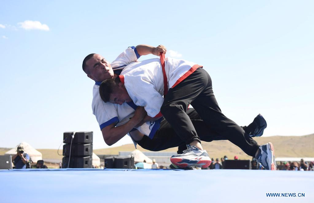 Herdsmen compete in a wrestling game during a tourism festival in Fuhai County of Altay, northwest China's Xinjiang Uygur Autonomous Region, June 3, 2021. (Xinhua/Sadat)