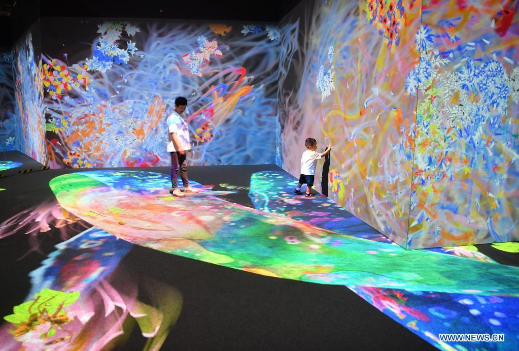 People visit the teamLab Future Park during an art festival themed on science and technology in Xi'an, northwest China's Shaanxi Province, June 6, 2021. (Xinhua/Shao Rui)