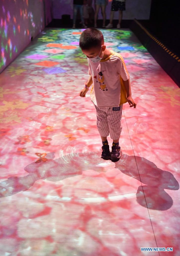 A boy visits the teamLab Future Park during an art festival themed on science and technology in Xi'an, northwest China's Shaanxi Province, June 6, 2021. (Xinhua/Shao Rui)