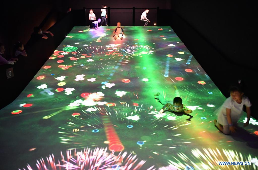 Children enjoy themselves at the teamLab Future Park during an art festival themed on science and technology in Xi'an, northwest China's Shaanxi Province, June 6, 2021. (Xinhua/Shao Rui)