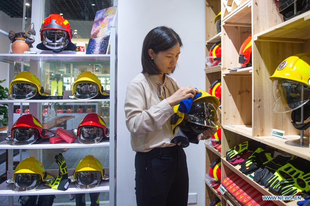 An exhibitor sorts out protective gear from Poland at the 2nd China-Central and Eastern European Countries (CEEC) Expo in Ningbo, east China's Zhejiang Province, June 8, 2021. The 2nd China-CEEC Expo opened in Ningbo on Tuesday. (Xinhua/Jiang Han)