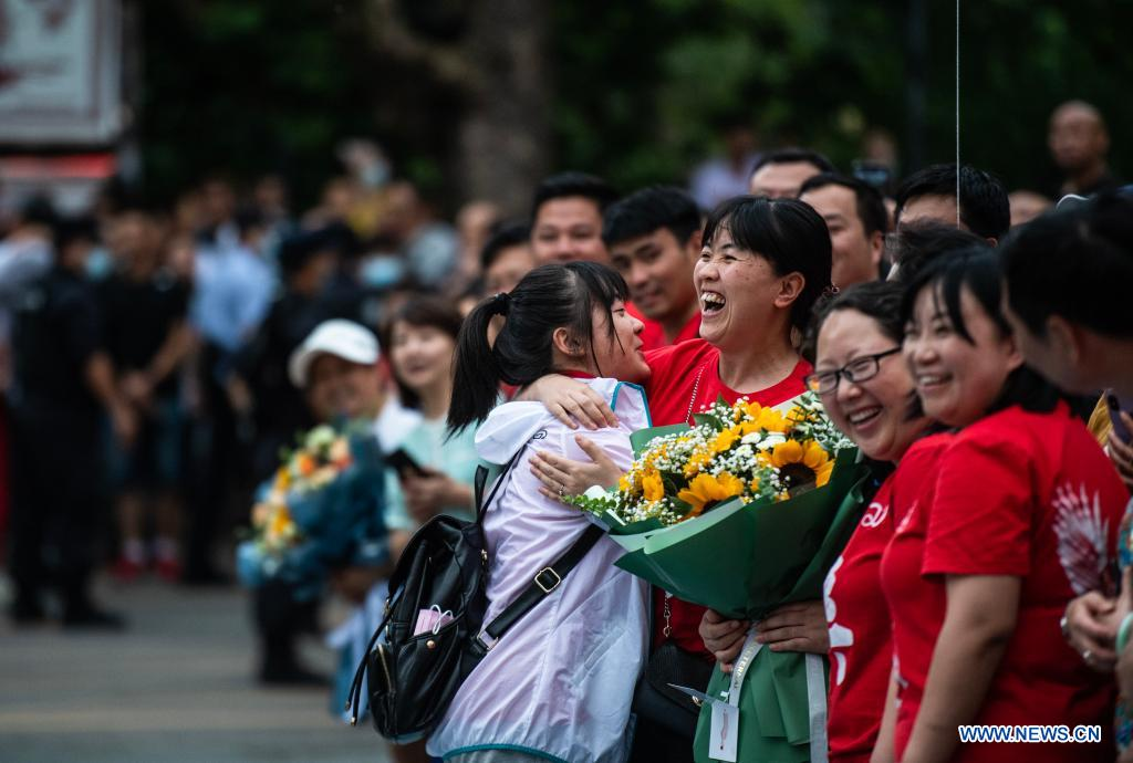 An examinee hugs her teacher at an exam site of a high school in Guiyang, the capital city of southwest China's Guizhou Province, June 8, 2021. China's annual college entrance exam concluded on Tuesday in some parts of the country. Considered the world's most grueling test, the exam, better known as the Gaokao, saw a record 10.78 million candidates signing up this year. (Xinhua/Tao Liang)