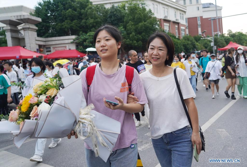 An examinee is greeted by her parent (R, front) while walking out of an exam site at a high school in Nanchang, the capital city of east China's Jiangxi Province, June 8, 2021. China's annual college entrance exam concluded on Tuesday in some parts of the country. Considered the world's most grueling test, the exam, better known as the Gaokao, saw a record 10.78 million candidates signing up this year. (Xinhua/Wan Xiang)