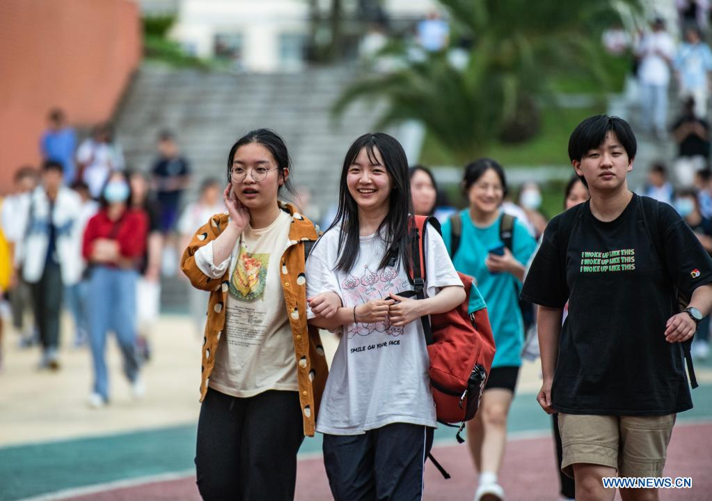 Examinees walk out of an exam site at a high school in Guiyang, the capital city of southwest China's Guizhou Province, June 8, 2021. China's annual college entrance exam concluded on Tuesday in some parts of the country. Considered the world's most grueling test, the exam, better known as the Gaokao, saw a record 10.78 million candidates signing up this year. (Xinhua/Tao Liang)
