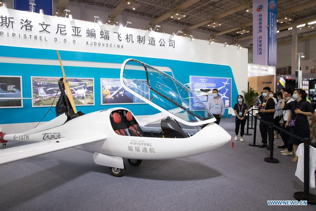 Visitors view a plane from Slovenia at the second China-Central and Eastern European Countries (CEEC) Expo in Ningbo, east China's Zhejiang Province, June 9, 2021. The expo opened to public visitors on Wednesday. Themed