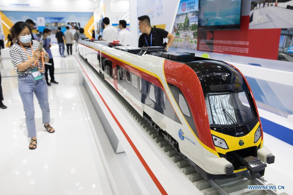 A visitor takes photos of a bullet train model at the second China-Central and Eastern European Countries (CEEC) Expo in Ningbo, east China's Zhejiang Province, June 9, 2021. The expo opened to public visitors on Wednesday. Themed
