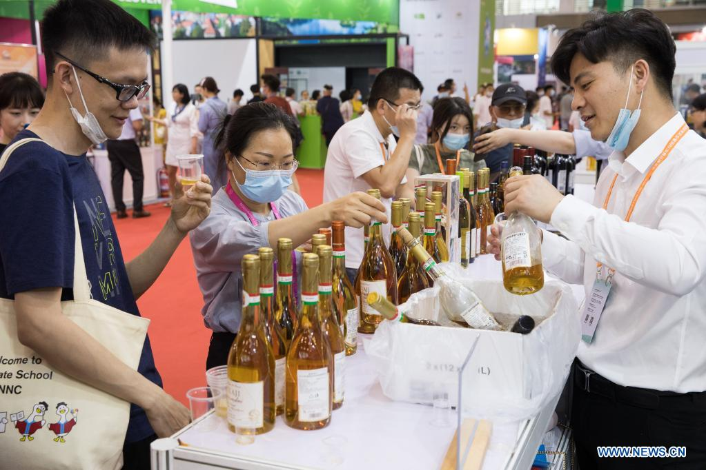 Visitors taste Hungarian wine at the second China-Central and Eastern European Countries (CEEC) Expo in Ningbo, east China's Zhejiang Province, June 9, 2021. The expo opened to public visitors on Wednesday. Themed