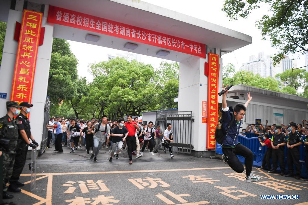 Examinees run out of an exam site at a middle school in Changsha, capital of central China's Hunan Province, June 9, 2021. China's annual college entrance exam concluded on Tuesday in some parts of the country. (Xinhua/Xue Yuge)