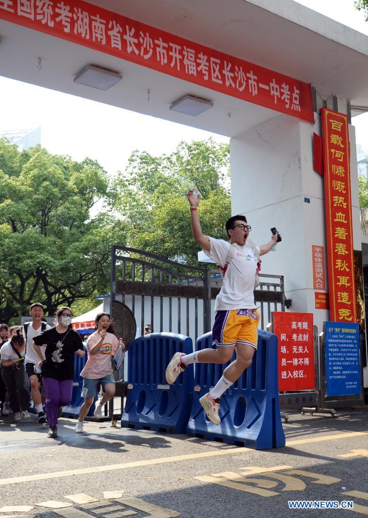 Examinees run out of an exam site at a middle school in Changsha, capital of central China's Hunan Province, June 9, 2021. China's annual college entrance exam concluded on Tuesday in some parts of the country. (Xinhua/Chen Zhenhai)