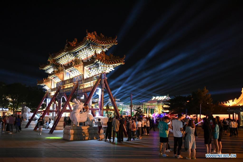 Tourists visit a tourism spot in Hohhot, north China's Inner Mongolia Autonomous Region, June 10, 2021. Various activities such as appreciating traditional music and tasting local food are held here to promote tourism. (Xinhua/Bei He)