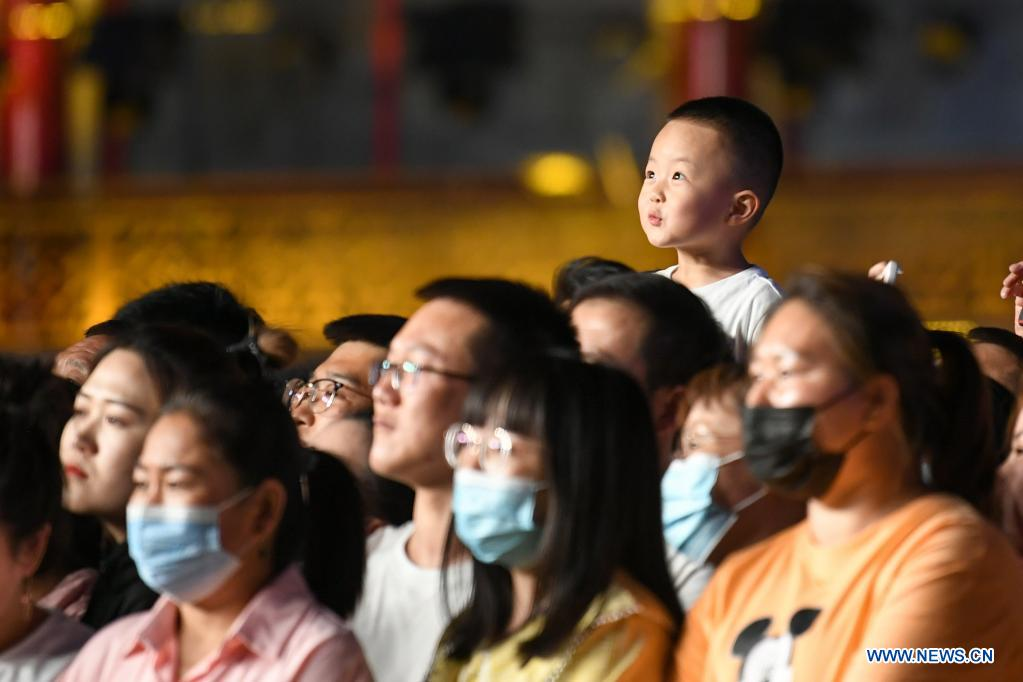 Audience enjoy a show at a culture and tourism event in Hohhot, north China's Inner Mongolia Autonomous Region, June 10, 2021. Various activities such as appreciating traditional music and tasting local food are held here to promote tourism. (Xinhua/Bei He)