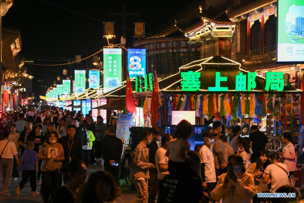 Tourists visit an old street in Hohhot, north China's Inner Mongolia Autonomous Region, June 10, 2021. Various activities such as appreciating traditional music and tasting local food are held here to promote tourism. (Xinhua/Bei He)