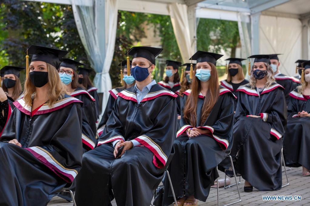 Students participate in a graduation ceremony at Riga Stradins University in Riga, Latvia, on June 29, 2021. (Photo by Edijs Palens/Xinhua)