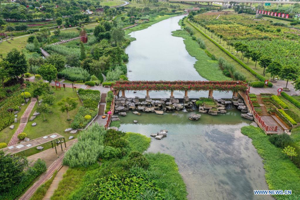 Aerial photo taken on July 11, 2021 shows the Nakao River wetland park in Nanning, south China's Guangxi Zhuang Autonomous Region. Nakao River in Nanning was once a polluted muddy gutter lined with sewage outlets. In 2015, a public-private partnership (PPP) project was rolled out to improve the ecological environment along the river. Pollution control measures including sewage interception and treatment, as well as aquatic ecosystem restoration, have helped turn the river into a wetland park with lucid waters. (Xinhua/Cao Yiming)