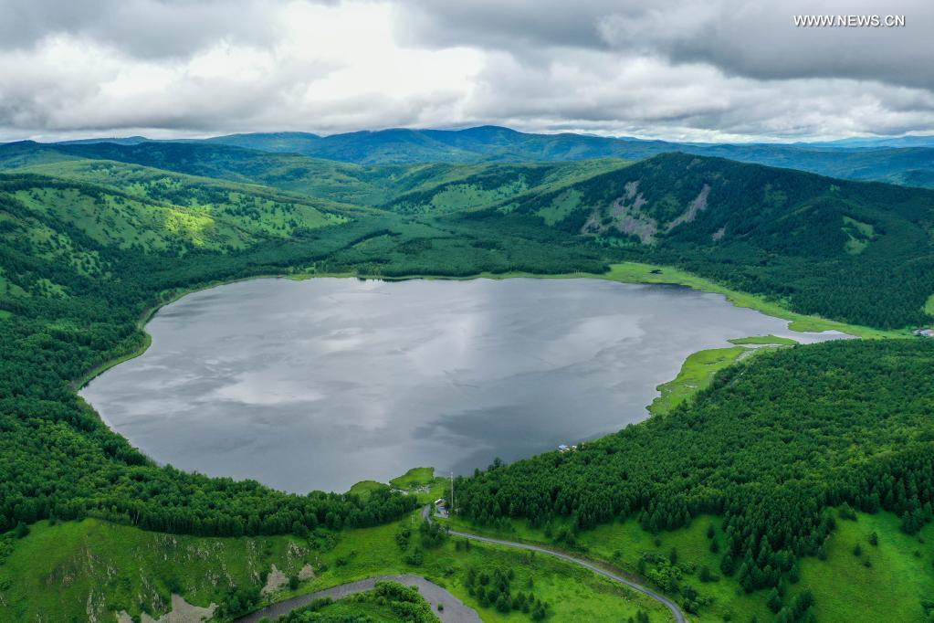 Aerial photo taken on July 14, 2021 shows the Wusulangzi Lake in the Arxan National Forest Park, north China's Inner Mongolia Autonomous Region. (Xinhua/Lian Zhen)