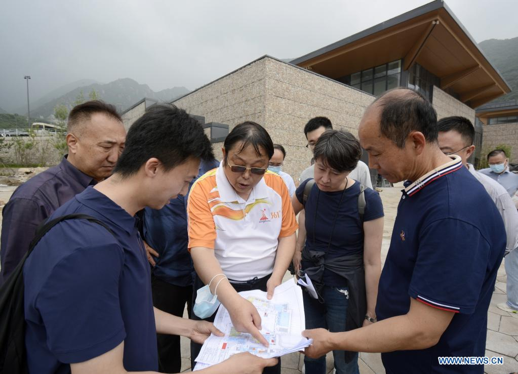 Experts check a map during a barrier-free facilities inspection at the athletes' village for the Beijing 2022 Paralympic Winter Games in Beijing's northwestern Yanqing district, China, July 15, 2021. (Xinhua/Li Xin)