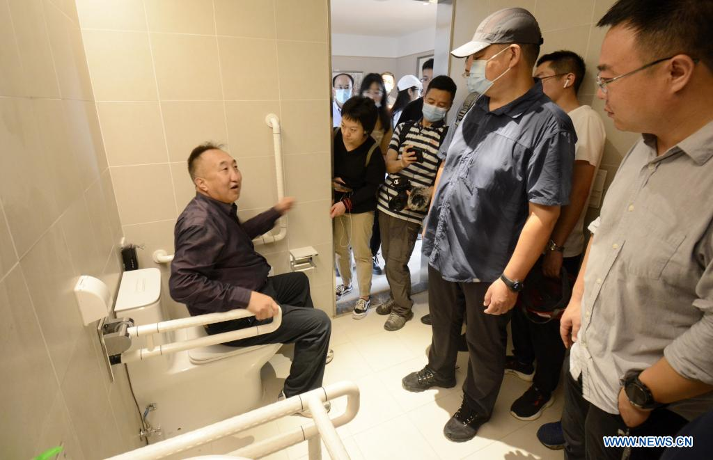 Experts check the barrier-free toilet facilities at the athletes' village for the Beijing 2022 Paralympic Winter Games in Beijing's northwestern Yanqing district, China, July 15, 2021. (Xinhua/Li Xin)