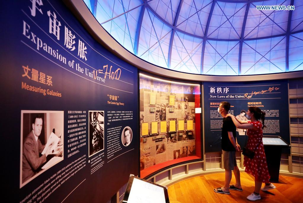 People view an exhibition introducing astronomy theories at the Shanghai Astronomy Museum in east China's Shanghai, July 18, 2021. The Shanghai Astronomy Museum, the world's largest planetarium in terms of building scale, opened to the public on Sunday. Covering an area of approximately 58,600 square meters, the museum is located in the China (Shanghai) Pilot Free Trade Zone Lingang Special Area. It is a branch of the Shanghai Science and Technology Museum. (Xinhua/Fang Zhe)