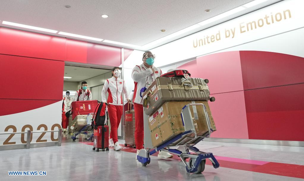 Zhang Jun (front), president of the Chinese Badminton Association, arrives with members of Chinese Olympic delegation at the Narita airport in Tokyo, Japan, July 18, 2021. (Xinhua/Li Yibo)