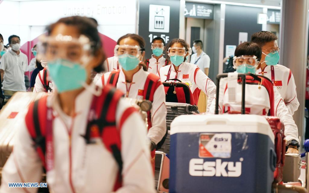 Members of Chinese Olympic delegation arrive at the Narita airport in Tokyo, Japan, July 18, 2021. (Xinhua/Li Yibo)