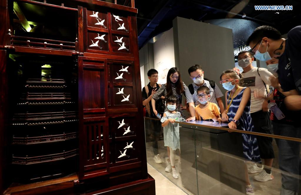 People visit the Shanghai Astronomy Museum in east China's Shanghai, July 18, 2021. The Shanghai Astronomy Museum, the world's largest planetarium in terms of building scale, opened to the public on Sunday. Covering an area of approximately 58,600 square meters, the museum is located in the China (Shanghai) Pilot Free Trade Zone Lingang Special Area. It is a branch of the Shanghai Science and Technology Museum. (Xinhua/Fang Zhe)