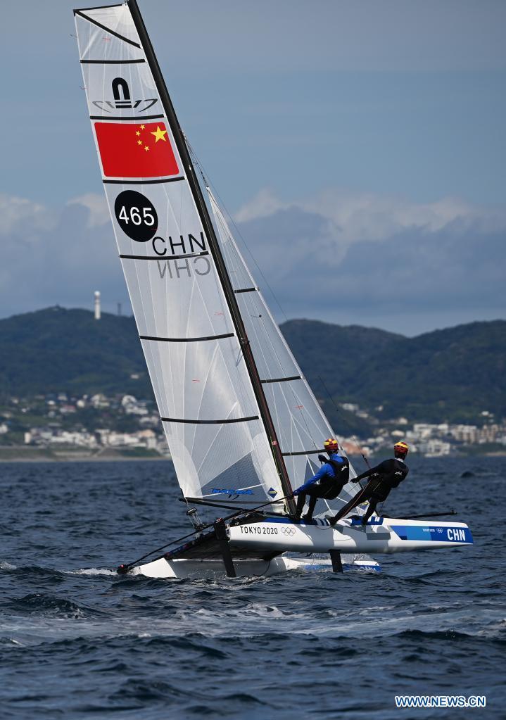 Chinese sailors of the Nacra 17 Mixed class Hu Xiaoxiao(R) and Yang Xuezhe attend a training session at Enoshima Yacht Harbour, in Kanagawa, Japan, on July 20, 2021. (Xinhua/Huang Zongzhi)