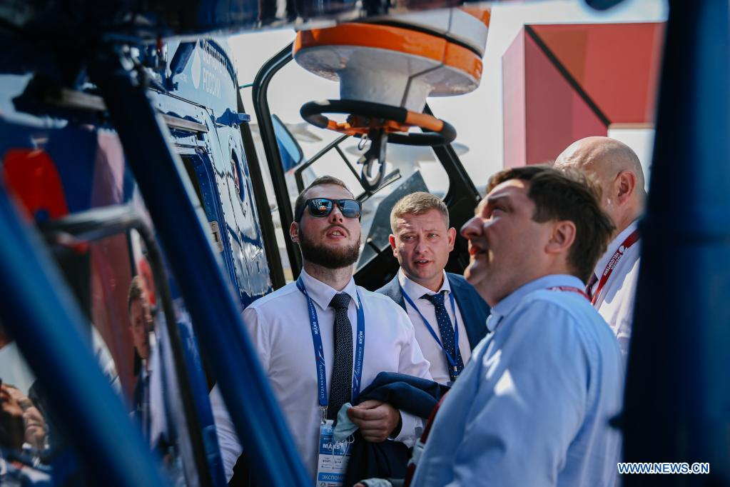 Visitors view a Ka-226T helicopter during the opening day of the International Aviation and Space Salon (MAKS)-2021 in a Moscow suburb, Russia, on July 20, 2021. MAKS-2021 kicked off in a Moscow suburb on Tuesday. (Xinhua/Evgeny Sinitsyn)