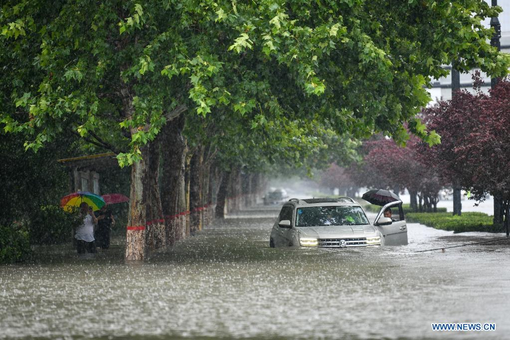 A car is inundated by rainwater in Zhengzhou, capital of central China's Henan Province, July 20, 2021. More than 144,660 residents have been affected by torrential rains in central China's Henan Province since July 16, and 10,152 have been relocated to safe places, the provincial flood control and drought relief headquarters said Tuesday. A total of 16 large and medium-sized reservoirs have seen water levels rise above the alert level after torrential rains battered most parts of the province on Monday and Tuesday. (Photo by Hou Jianxun/Xinhua)