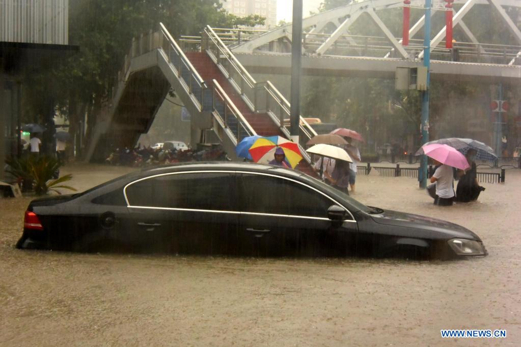 A car is inundated by rainwater in Zhengzhou, capital of central China's Henan Province, July 20, 2021. More than 144,660 residents have been affected by torrential rains in central China's Henan Province since July 16, and 10,152 have been relocated to safe places, the provincial flood control and drought relief headquarters said Tuesday. A total of 16 large and medium-sized reservoirs have seen water levels rise above the alert level after torrential rains battered most parts of the province on Monday and Tuesday. (Xinhua/Zhu Xiang)