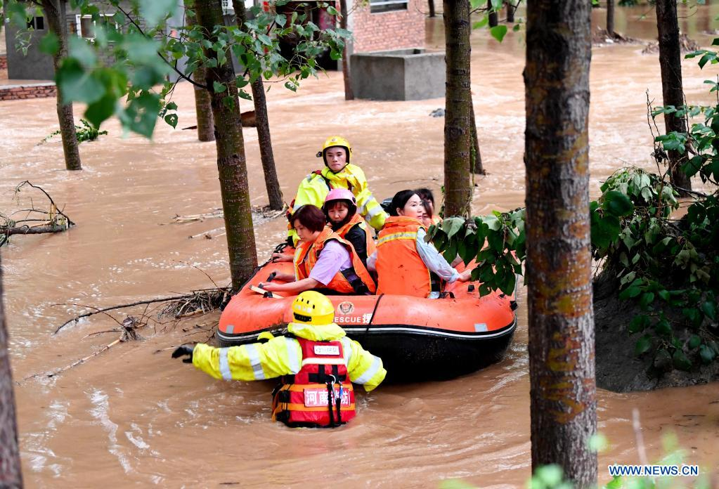 Rescuers transfer stranded villagers in Longtou Village, Dengfeng City of central China's Henan Province, July 20, 2021. Longtou Village was hit by mountain torrents on Tuesday. Rescuers have transferred over 50 villagers to safer places. (Xinhua/Hao Yuan)