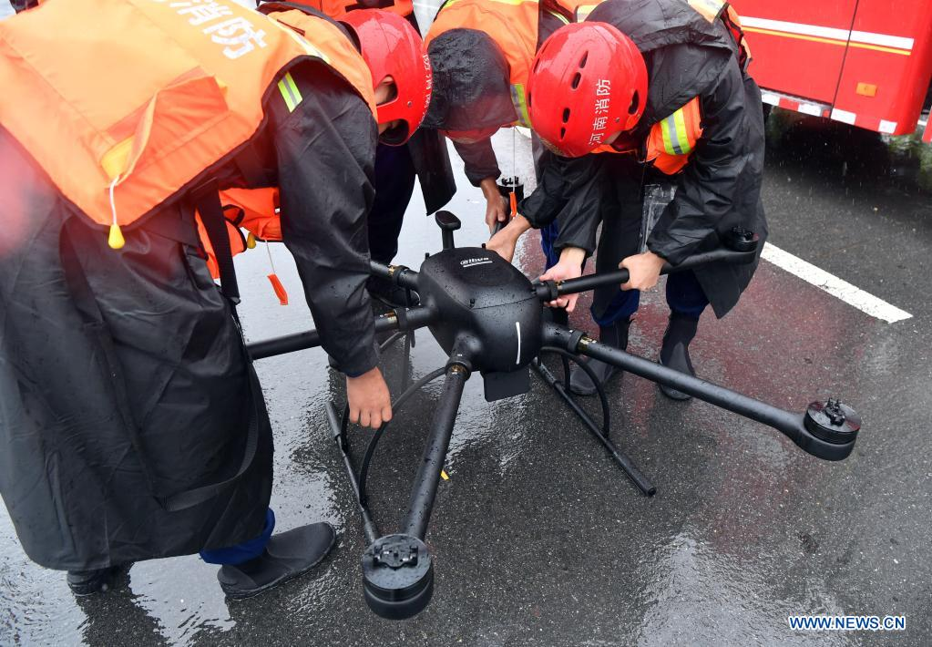 Fire fighters operate a drone to carry out the work of flood control in Zhouzhuang Township, Xiuwu County of Jiaozuo, central China's Henan Province, July 20, 2021. Rivers in Jiaozuo have witnessed rising water level as continuous rainfalls recently hit the city. Local authorities have organized flood-control workers to patrol the city around the clock and eliminate hidden dangers to protect the safety of people's lives and property. (Xinhua/Li Jianan)