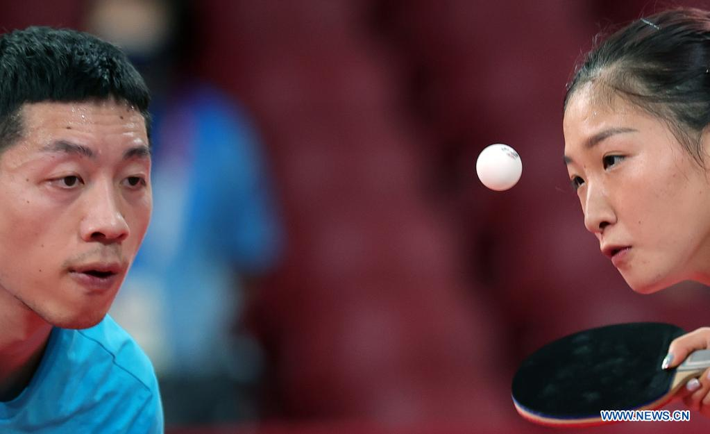 Chinese table tennis players Liu Shiwen(R) and Xu xin attend a training session ahead of the Tokyo 2020 Olympic Games at Tokyo Metropolitan Gymnasium in Tokyo, Japan, July 21, 2021. (Xinhua/Wang Dongzhen)