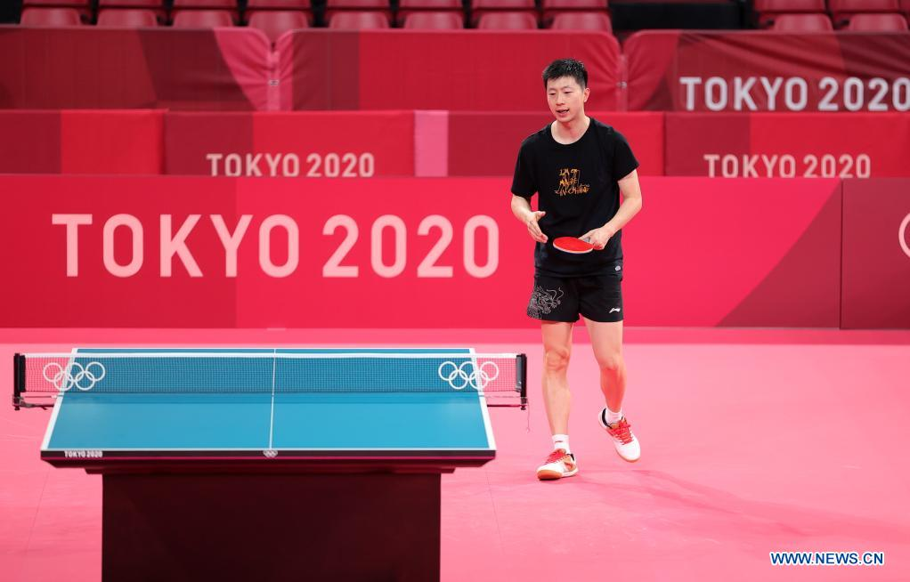 Chinese table tennis player Ma Long reacts during a training session ahead of the Tokyo 2020 Olympic Games at Tokyo Metropolitan Gymnasium in Tokyo, Japan, July 21, 2021. (Xinhua/Wang Dongzhen)