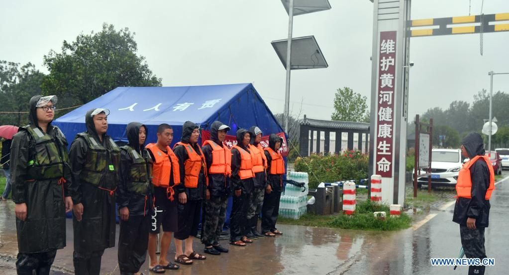Flood-control workers prepare to patrol Danhe River in Chenzhuang Village, Motou Township, Bo'ai County of Jiaozuo, central China's Henan Province, July 20, 2021. Rivers in Jiaozuo have witnessed rising water level as continuous rainfalls recently hit the city. Local authorities have organized flood-control workers to patrol the city around the clock and eliminate hidden dangers to protect the safety of people's lives and property. (Xinhua/Li Jianan)