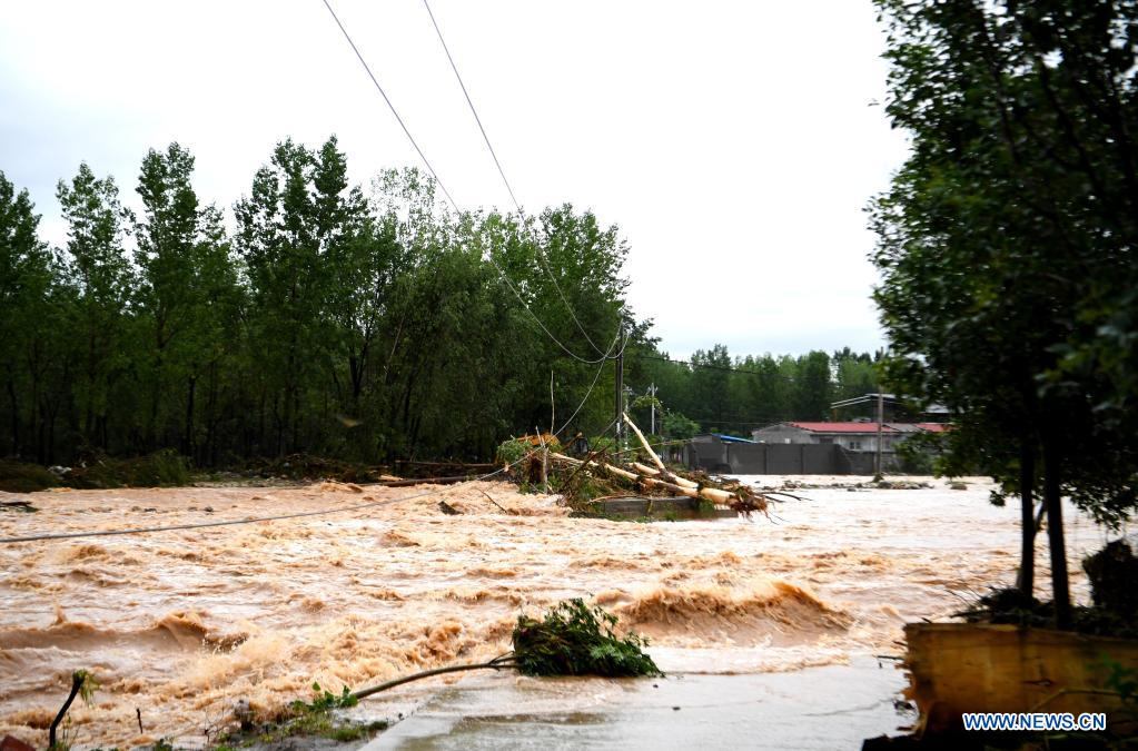 Floods are seen in Longtou Village, Dengfeng City of central China's Henan Province, July 20, 2021. Longtou Village was hit by mountain torrents on Tuesday. Rescuers have transferred over 50 villagers to safer places. (Xinhua/Hao Yuan)