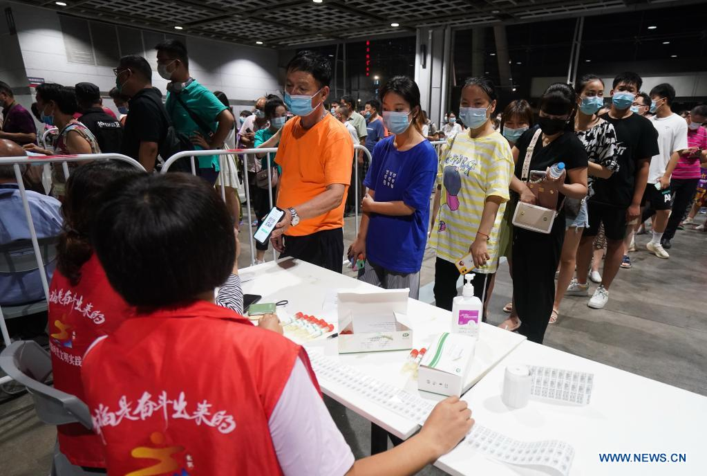 People register for COVID-19 test at a testing site in Nanjing, east China's Jiangsu Province, July 21, 2021. Nanjing, which has a population of more than 9.3 million, carried out citywide nucleic acid testing starting on Wednesday. (Xinhua/Ji Chunpeng)