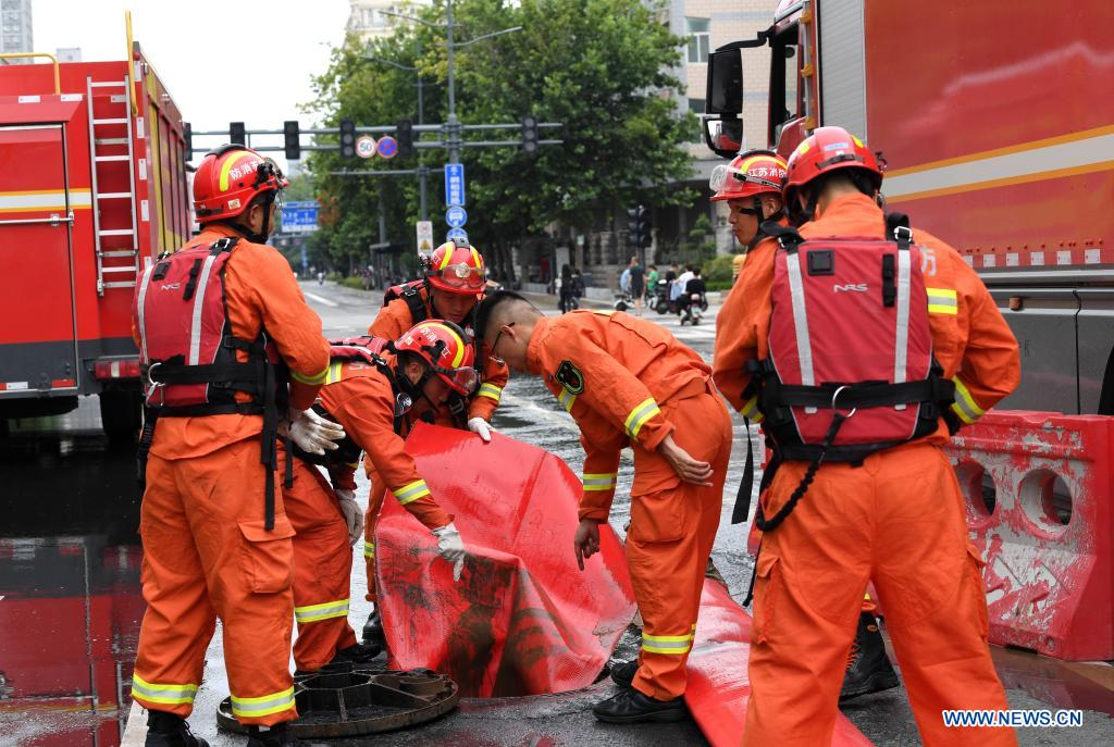 Firefighters check the drainage system in Zhengzhou, capital of central China's Henan Province, July 21, 2021. Extremely heavy rainfall hit Henan on Tuesday, with precipitation in Zhengzhou, exceeding the highest level on local weather records. A rescue team of 1,800 firefighters has been deployed to the flood-hit region from seven neighboring provinces, together with boats, pumping vehicles, and flood rescue kits. (Xinhua/Hao Yuan)