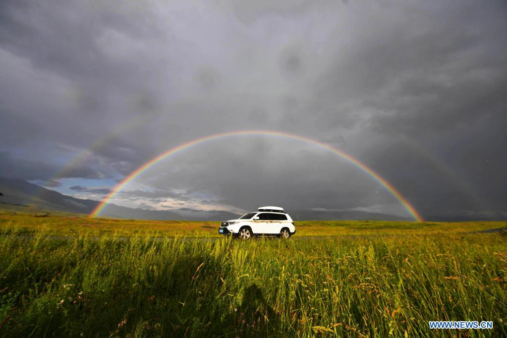 Photo taken on July 24, 2021 shows a rainbow arching across the sky in Hemu Village of Kanas in Altay, northwest China's Xinjiang Uygur Autonomous Region. The Kanas scenic area, which is at the height of the tourist season, received over 6.2 million tourists from May 1 to July 27, according to the local authority. (Xinhua/Sadat)