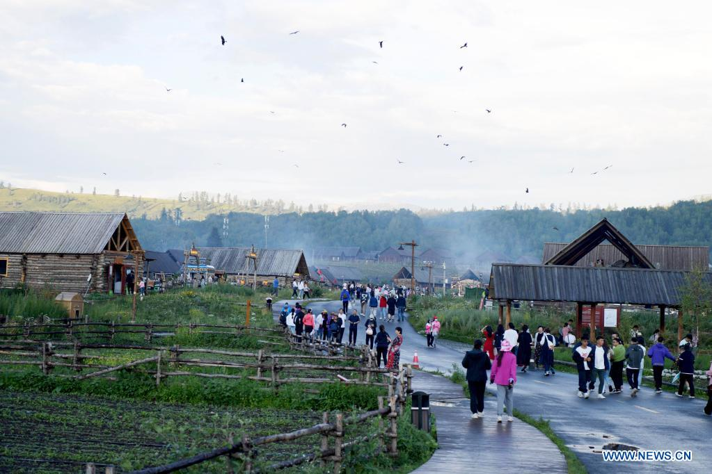 Tourists go sightseeing in Hemu Village of Kanas in Altay, northwest China's Xinjiang Uygur Autonomous Region, July 24, 2021. The Kanas scenic area, which is at the height of the tourist season, received over 6.2 million tourists from May 1 to July 27, according to the local authority. (Xinhua/Sadat)