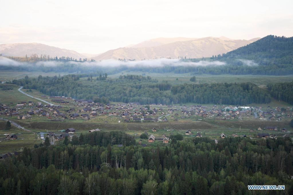 Photo taken on July 24, 2021 shows the scenery of Hemu Village of Kanas in Altay, northwest China's Xinjiang Uygur Autonomous Region. The Kanas scenic area, which is at the height of the tourist season, received over 6.2 million tourists from May 1 to July 27, according to the local authority. (Xinhua/Sadat)