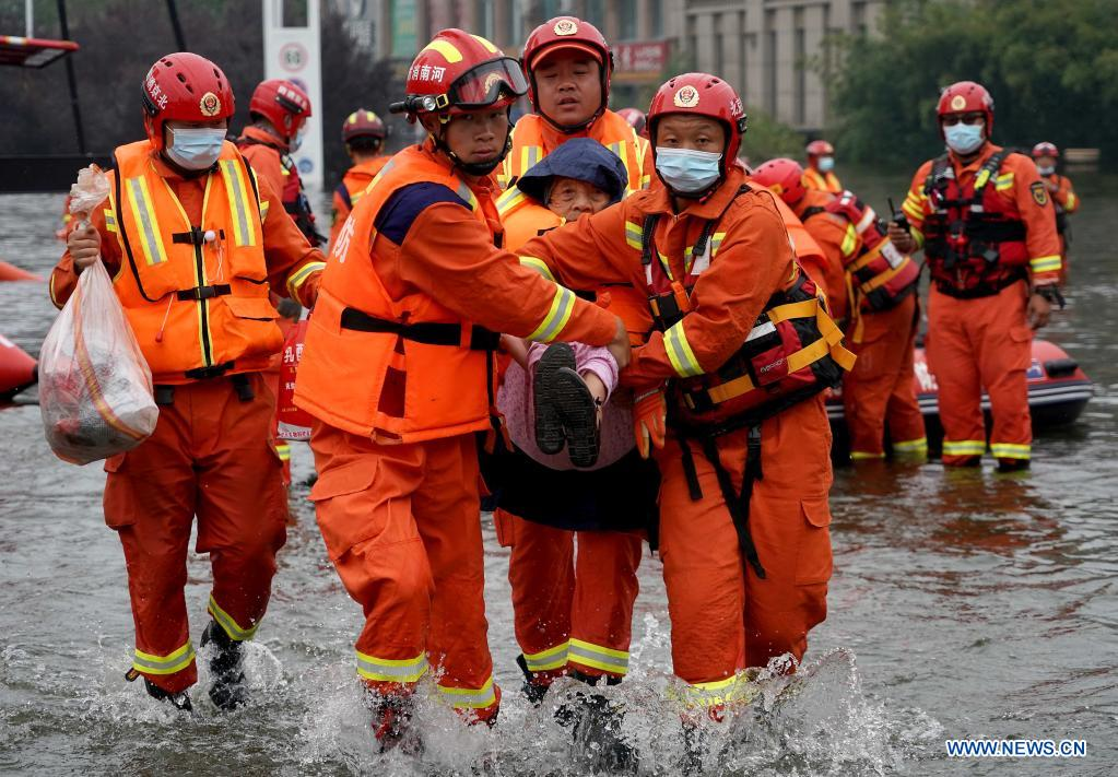 Rescuers transfer an elderly in Weihui City, central China's Henan Province, July 28, 2021. Weihui City suffered from severe urban waterlogging due to the extremely heavy rainfall. Rescue and drainage work is still in progress there. (Xinhua/Li An)