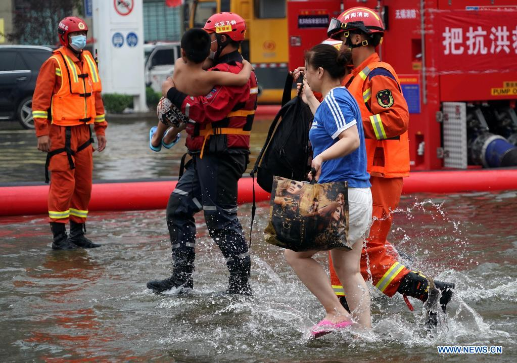Rescuers transfer stranded people in Weihui City, central China's Henan Province, July 28, 2021. Weihui City suffered from severe urban waterlogging due to the extremely heavy rainfall. Rescue and drainage work is still in progress there. (Xinhua/Li An)