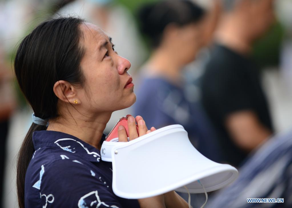 A woman mourns in front of a memorial wall at the Tangshan Earthquake Memorial Park in Tangshan, north China's Hebei Province, July 28, 2021. Wednesday marks the 45th anniversary of the Tangshan earthquake. The 7.8-magnitude quake struck the city of Tangshan in Hebei Province on July 28, 1976, killing more than 240,000 people and destroying virtually all buildings. (Xinhua/Jin Haoyuan)