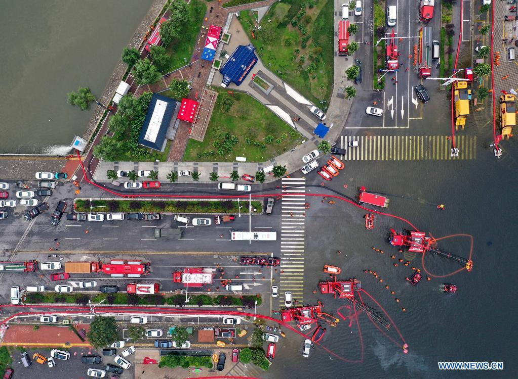 Aerial photo shows rescuers pumping rainwater out of a road in the waterlogged urban area of Weihui City, central China's Henan Province, July 28, 2021. Weihui City suffered from severe urban waterlogging due to the extremely heavy rainfall. Rescue and drainage work is still in progress there. (Xinhua/Li An)